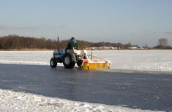 Cleaning ice outdoors Royalty Free Stock Photos