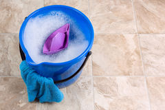 Cleaning. Image of a bucket with rag and water for cleaning Stock Photos