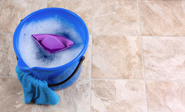 Cleaning. Image of a bucket with rag and water for cleaning Royalty Free Stock Photo