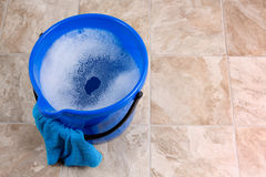 Cleaning. Image of a bucket with rag and water for cleaning Royalty Free Stock Images