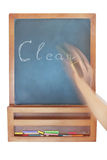 Cleaning the inscription on the chalkboard. Royalty Free Stock Photos