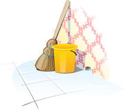 Cleaning Items. Broom and trash can near the wall Stock Photos