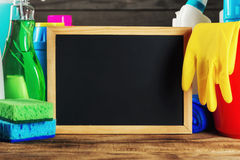 Cleaning items with empty chalkboard close up Royalty Free Stock Photos