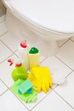 Cleaning items gloves brush white toilet bowl bathroom royalty free stock images