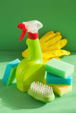 Cleaning items household spray brush sponge glove Stock Photo