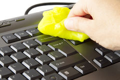 Cleaning the keyboard. Hand who clean the keyboard with a special sponge stock photography