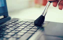 Cleaning keyboard and caring computer Royalty Free Stock Image