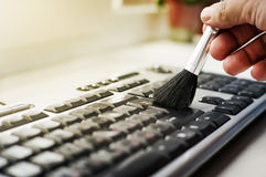 Cleaning keyboard from dust Stock Photography
