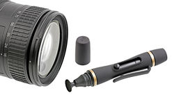 Cleaning kit and lens. Stock Photos