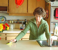 Cleaning the kitchen. Senior cleaning the kitchen after dinner royalty free stock images