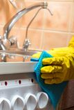 cleaning the kitchen - cleaning the stove royalty free stock photo