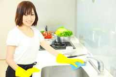 Cleaning kitchen Stock Photo