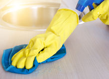 Cleaning kitchen countertop Stock Image