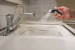 Cleaning the Kitchen Sink Royalty Free Stock Image