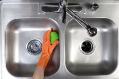 Cleaning Kitchen Sink Royalty Free Stock Images