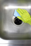Cleaning Kitchen Sink stock images