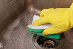 Cleaning Kitchen Sink Royalty Free Stock Image