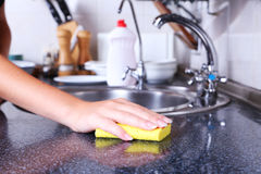 Cleaning kitchen with yellow sponge Stock Image