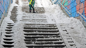 Cleaning  ladder of snow and ice. Royalty Free Stock Photos