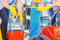 Cleaning ladies mopping floor. Close up on hands and tools Stock Photos