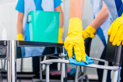 Cleaning ladies working as team in office. Commercial cleaning crew ladies working as team in office royalty free stock photo