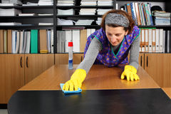 Cleaning lady. Professional cleaning lady at her work in the office royalty free stock photos