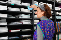 Cleaning lady. Professional cleaning lady at her work in the office royalty free stock images
