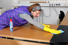 Cleaning lady. Professional cleaning lady at her work in the office stock images