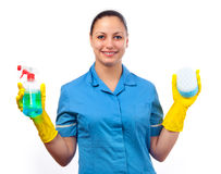 Cleaning lady with bottle of detergent and sponge. Smiling cleaning lady holding bottle of detergent in one hand and sponge in the other isolated on white Royalty Free Stock Images