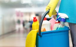 Cleaning lady with a bucket and cleaning products . royalty free stock photography