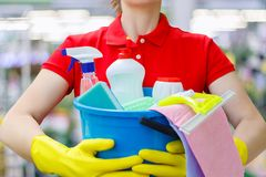 Cleaning lady with a bucket and cleaning products . royalty free stock images