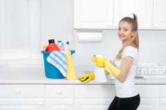 Cleaning lady with bucket of cleaning supplies stock photo