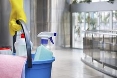 Cleaning lady with a bucket and cleaning products . Cleaning lady with a bucket and cleaning products before washing the floor stock photography