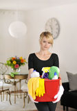Cleaning lady with cleaning supplies Royalty Free Stock Photo