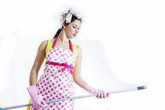 Cleaning lady dreams of playing guitar with the broom handle Royalty Free Stock Photography