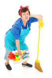 Cleaning Lady - Exhausted. Humorous image of an exhausted, overworked cleaning lady. Full body isolated on white stock images