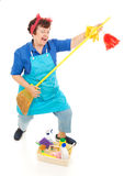 Cleaning Lady Fun. Cleaning lady takes a break to have some fun playing air guitar on her broom. Full body isolated royalty free stock photography