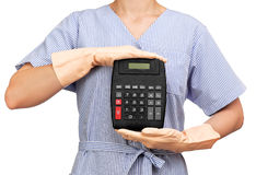 Cleaning lady holding a calculator Royalty Free Stock Image