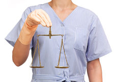 Cleaning lady holding a scale of justice Royalty Free Stock Image