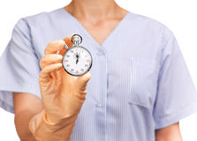Cleaning lady holding a stopwatch Royalty Free Stock Photo