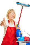 Cleaning lady holding thumbs up Royalty Free Stock Photos