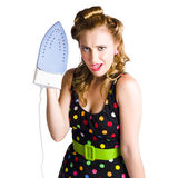 Cleaning lady with iron Royalty Free Stock Photos