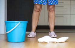Cleaning lady in the kitchen Royalty Free Stock Photo