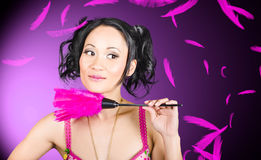 Cleaning lady maid dusting with feather duster Stock Photos