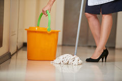 Cleaning lady with mop and bucket Royalty Free Stock Photo