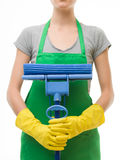 Cleaning lady with mop. Close-up of cleaning lady holding mop in front of her, on white background stock photography
