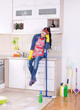 Cleaning lady restng on kitchen countertop stock images
