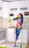 Cleaning lady restng on kitchen countertop Stock Photography