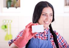Cleaning lady showing businesscard Stock Photos