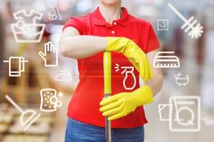 Cleaning lady standing with a MOP . stock images